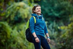 Woman hiker smiling standing outside in forest Royalty Free Stock Photo
