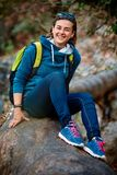 Woman hiker smiling standing outside in forest Stock Image