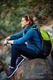 Woman hiker smiling standing outside in forest Stock Photos