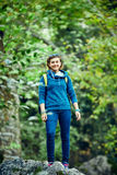 Woman hiker smiling standing outside in forest Royalty Free Stock Image