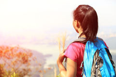 Woman hiker stand mountain peak stock image