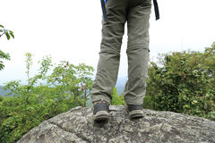 Woman hiker stand on mountain peak Royalty Free Stock Image