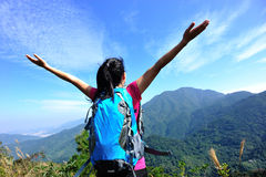 Woman hiker stand mountain peak Stock Photo