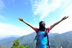 Woman hiker stand mountain peak Royalty Free Stock Images