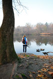 Woman hiker stand and relax on the riverbank Stock Photo