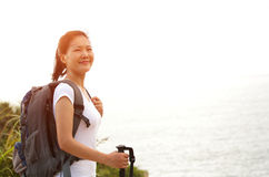 Woman hiker  stand at seaside mountain Royalty Free Stock Photos