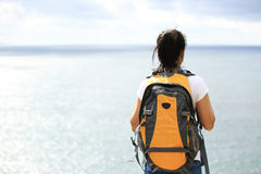 Woman hiker stand seaside Stock Photo