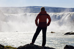 Woman Hiker Standing In Front Of a Huge Waterfall Royalty Free Stock Photos