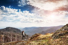 Woman hiker standing on top of the mountain Stock Photos