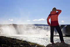 Woman Hiker Standing At A Waterfall, Iceland Royalty Free Stock Photos
