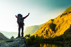 Woman hiker stands with backpack royalty free stock photo