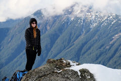 A Woman Hiker Stands on The Summit of Mt Dickerman. Royalty Free Stock Photography