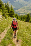 Woman hiker on a steep trail Royalty Free Stock Photo