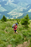 Woman hiker on a steep trail Royalty Free Stock Images
