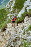 Woman hiker on a steep trail Stock Images