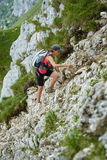 Woman hiker on a steep trail Stock Image