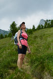 Woman hiker on a steep trail Royalty Free Stock Image