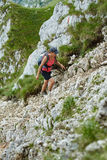 Woman hiker on a steep trail Stock Photo