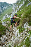 Woman hiker on a steep trail Royalty Free Stock Photography