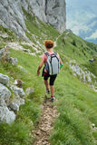 Woman hiker on a steep trail Stock Photos