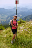 Woman hiker on a steep trail Stock Photography