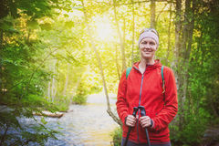 Woman hiker with sticks in forest. Tourism concept. Woman hiker with sticks in forest outdoor. Tourism concept Stock Photography