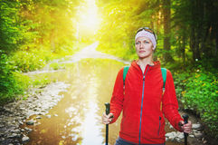 Woman hiker with sticks in forest. Tourism concept. Woman hiker with sticks in forest outdoor. Tourism concept Stock Photos