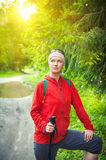 Woman hiker with sticks in forest. Tourism concept. Woman hiker with sticks in forest outdoor. Tourism concept Royalty Free Stock Photography