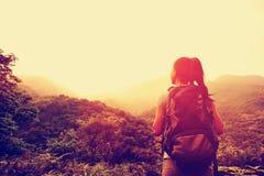 Woman hiker at sunrise mountain peak Royalty Free Stock Photography