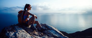 Woman hiker at sunrise seaside royalty free stock images
