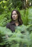 Woman Hiker Surrounded by Ferns Royalty Free Stock Photography
