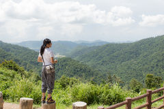Woman hiker taking photo with camera at mountain Royalty Free Stock Photography