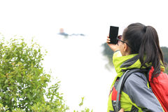 Woman hiker taking photo with cell phone Stock Photos