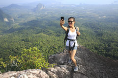 Woman hiker taking photo with cellphone Royalty Free Stock Image