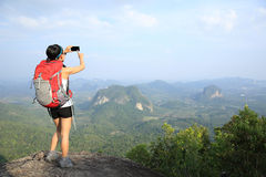 Woman hiker taking photo Royalty Free Stock Photography