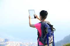Woman hiker taking photo Royalty Free Stock Photo
