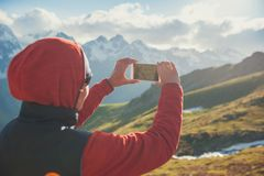 Woman hiker taking photo on the top of mountain Royalty Free Stock Photo