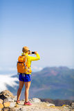 Woman hiker taking photos  in mountains Royalty Free Stock Photography