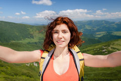 Woman hiker taking self photo on the mountain peak Stock Images