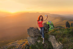 Woman hiker taking self photo on the mountain peak Royalty Free Stock Images