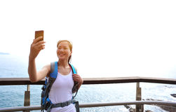 Woman hiker taking self photo Stock Images