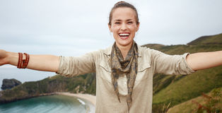 Woman hiker taking selfie in front of ocean view landscape Royalty Free Stock Photos