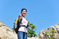 Woman hiker thumb up Stock Photos