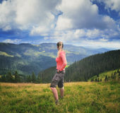 Woman hiker on a top of a mountain Royalty Free Stock Images