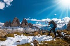 Woman hiker on top of mountain Stock Photos