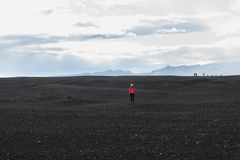 Woman hiker on the trail in the Islandic mountains. Trek in National Park. Of Iceland stock images