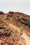 Woman hiker or trail runner in mountains Royalty Free Stock Photo