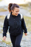 Woman hiker on a trail Stock Photos