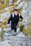Woman hiker on a trail Royalty Free Stock Photography