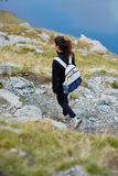 Woman hiker on a trail Stock Photo